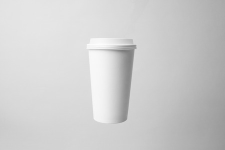Blank white paper cup in the air Banco de Imagens