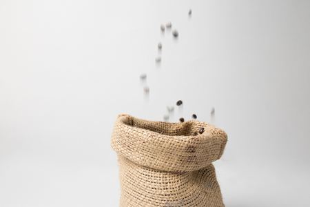 Coffee sack with beans falling down