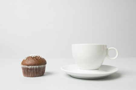 Coffee cup with a muffin