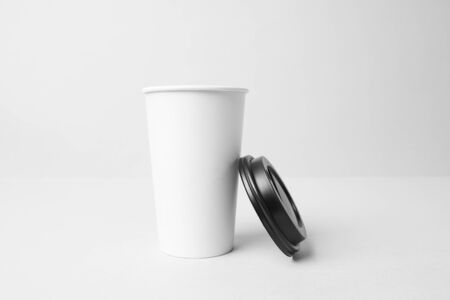 White paper cup with black cap mockup