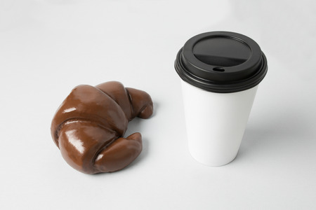 White paper cup with a chocolate croissant Banco de Imagens