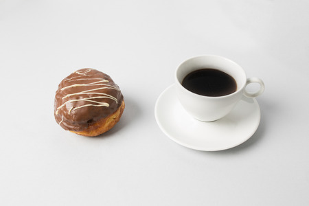 Coffee cup with a chocolate donut Banco de Imagens