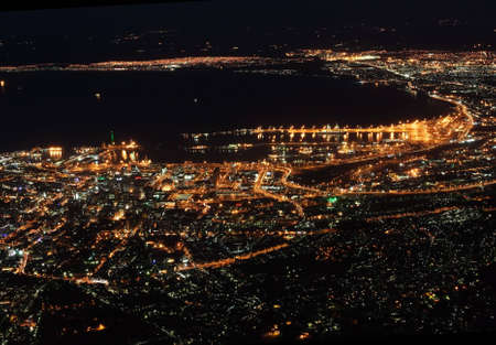 The city of Cape Town in South Africa at night as seen from Tablemountain. photo