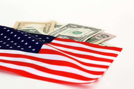 fund world: The stars and stripes with dollar bills of the USA