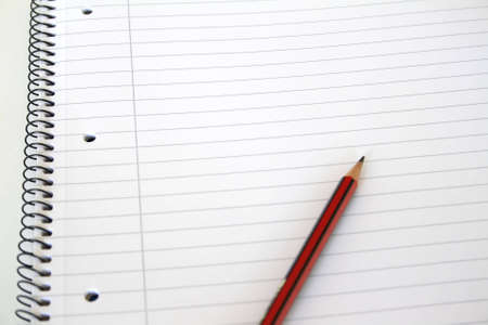 looseleaf: Lined notebook with pencil