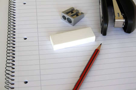 pencil,eracer and stapler on a notepad photo