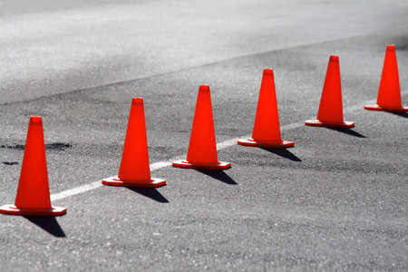 bollard: A row of safety cones blocking off a road Stock Photo