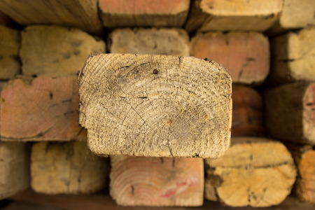 A stack of timber with one plank poking out.