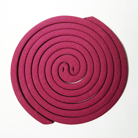 bobina: classic pink mosquito coil spiral isolated on white background
