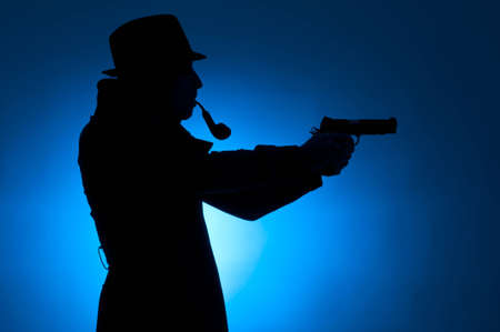 private detective: Silhouette of a private detective isolated on a blue background