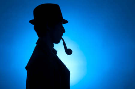 Silhouette of a private detective isolated on a blue background Stock Photo - 8654994