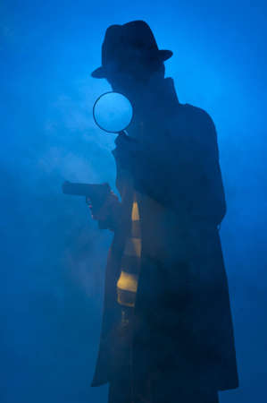 fedora hat: Private detective searching for information, isolated on a blue background