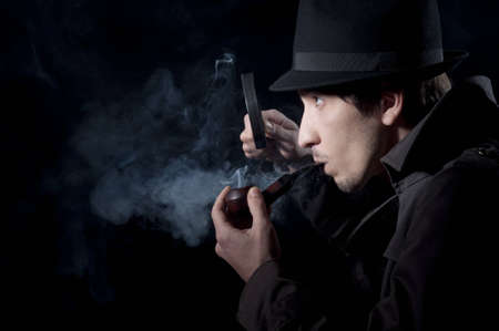 private investigator: Private detective searching for information, isolated on a black background