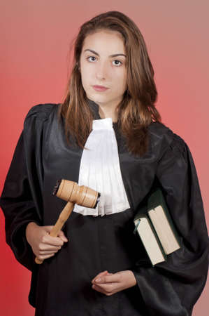 Young law school student holding statute books photo
