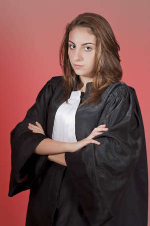 Serious young law school student, isolated on red photo