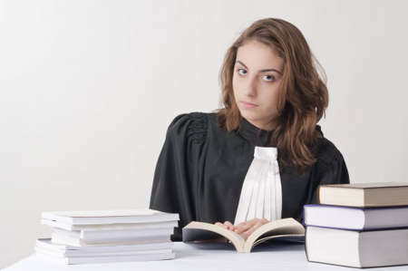 statute: Young law school student studying from her statute books