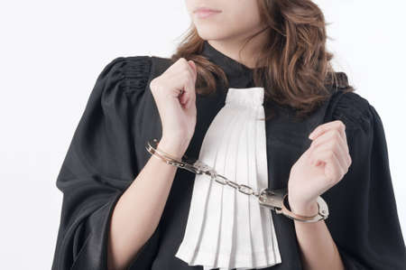 Young law school student holding statute books blindfolded and handcuffed Stock Photo - 9041651