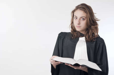 statute: Young law school student holding the statute book Stock Photo