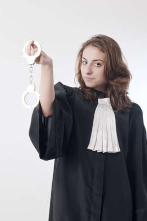 Young law school student holding a pair of handcuffs photo