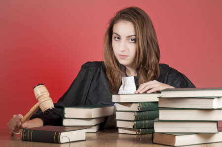 Concentrated young law school student holding the law hammer photo