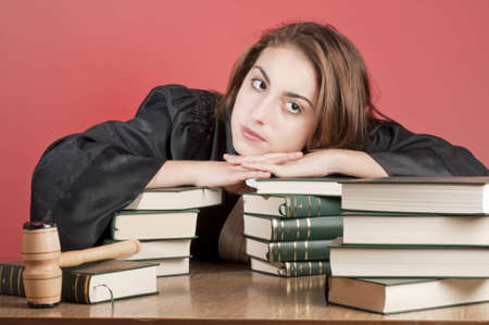 Young law school student surrounded by statute books photo