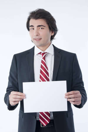 advert: Businessman holding an empty advert in his hands Stock Photo