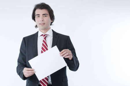 Businessman holding an empty advert in his hands photo