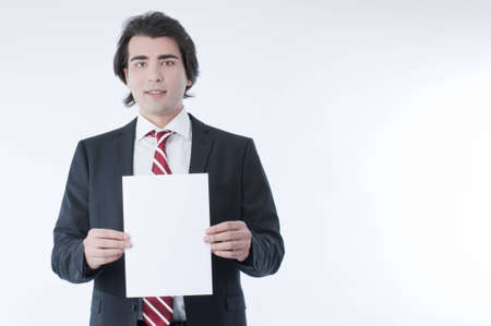 young add: Businessman holding an empty advert in his hands Stock Photo
