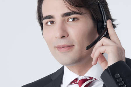 Isolated studio picture from a young callcenter agent  Stock Photo
