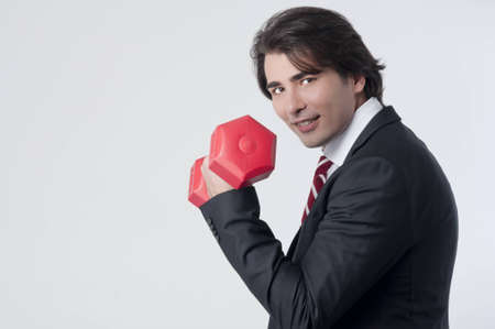 Businessman training with a weightlifting