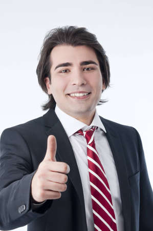 Man gesturing ok success sign isolated over white.  photo