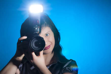 Attractive young photographer holding her camera