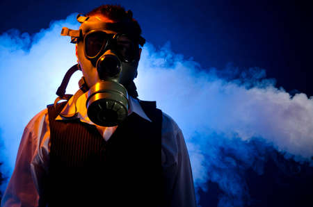 Man wearing a gas mask for protection against pollution Stock Photo - 11536760