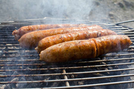 Sausages cooking on the grill