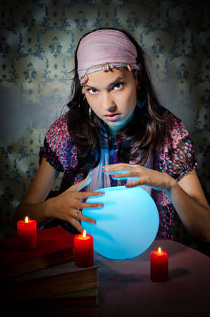 gypsies: Young woman playing fortune-teller Stock Photo