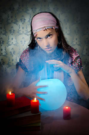 Young woman playing fortune-teller Stock Photo