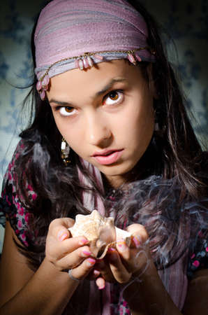 gypsy woman: Young woman playing fortune-teller Stock Photo