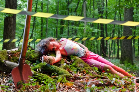 A dead girls body found in the forest Stock Photo