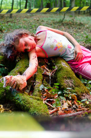 murder scene: A dead girls body found in the forest Stock Photo