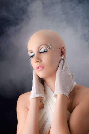 fake diamond: Model with a fake bald   Stock Photo