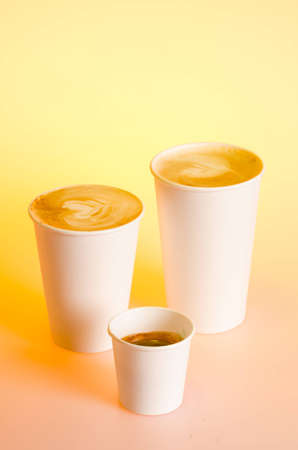 to go cup: Group of different coffee drinks sizes in cardboard cups