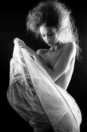 Young woman wearing a crinoline shooted over a black background