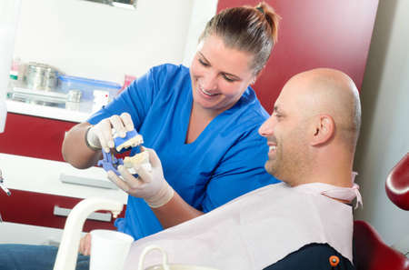 A patient asks his dentist about a dental mold photo