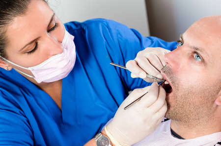 A dentist carrying out a dental examination Stock Photo