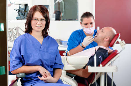 tooth decay: A dentist carrying out a dental examination Stock Photo
