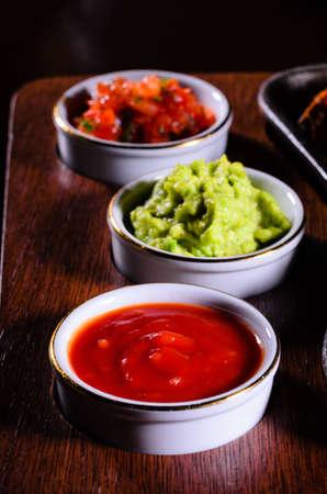 serape: Varied chilli sauces for fajitas