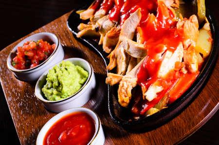 fajita: Original hot fajita served on wood plate