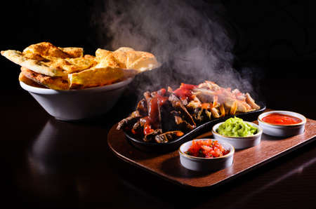 mexican food: Original hot fajita served on wood plate