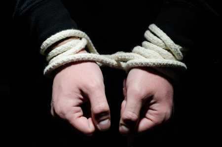 emotional freedom: Hands tied up with rope Stock Photo