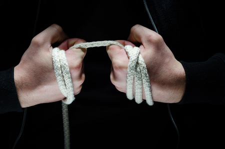 Criminal hands holding a rope photo